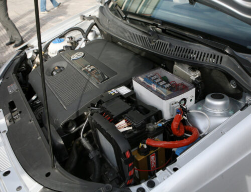 Conversion of a commercial gasoline vehicle to run bi-fuel (hydrogen-gasoline)